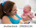 mother giving birth to a baby.... | Shutterstock . vector #298281134