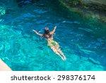 young woman swimming between... | Shutterstock . vector #298376174
