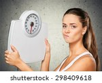 dieting  weight scale  women. | Shutterstock . vector #298409618