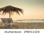 empty chairs under thatched... | Shutterstock . vector #298411103