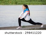 asian woman doing exercise at... | Shutterstock . vector #298411220