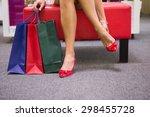 woman sitting next to shopping