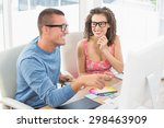 smiling colleagues pointing... | Shutterstock . vector #298463909