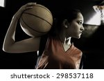 Girl posing with a basketball