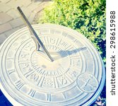 Old Sun Clock Dial In A Garden
