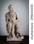 Moses Statue On Wooden Floor...