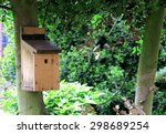 A Small Bird House Fixed To Th...