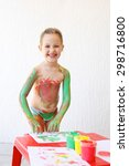 Small photo of Little girl body painting herself with non-toxic, washable finger paints, having fun with creative playing. Permissive upbringing, innovative learning, fun childhood concept.