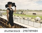 Stock photo beautiful lady in a proper outfit for horse racing day on the melbourne cup event on hippodrome 298789484