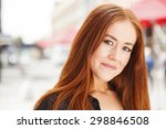 Young Woman With Red Hair...