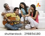 boy playing the guitar for his... | Shutterstock . vector #298856180