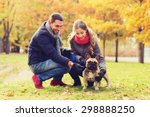 Stock photo care animals family season and people concept smiling couple with dog in autumn park 298888250