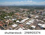 Small photo of Aerial view of Main Street in downtown Mesa, Arizona with light rail transportation near completion