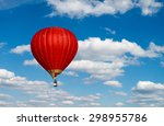 Red Hot Air Balloon In Blue...
