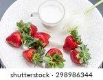 strawberry and glass of milk on ... | Shutterstock . vector #298986344