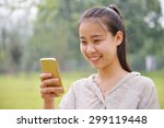happy girl looking at a mobile...   Shutterstock . vector #299119448