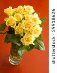 yellow roses bouquet on red table - stock photo