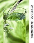 poring water in glass on green | Shutterstock . vector #29918662