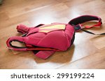 Red Parachute Pack Lying On Th...