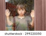 Little Boy Behind The Window In ...