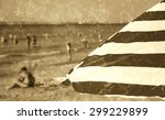 Striped Beach Umbrella And...