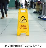 yellow sign that alerts for wet ... | Shutterstock . vector #299247446