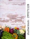 vegetables on wood background... | Shutterstock . vector #299271128