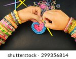young girl weaves heart with...   Shutterstock . vector #299356814