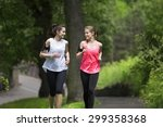 Two Athletic Woman Running...