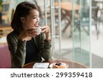 laughing woman drinking tea and ... | Shutterstock . vector #299359418