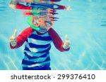 cute happy little boy swimming... | Shutterstock . vector #299376410