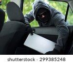 car theft   a laptop being... | Shutterstock . vector #299385248
