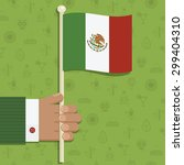 hand holding mexican flag on... | Shutterstock .eps vector #299404310