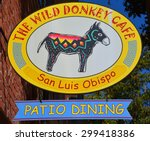 Small photo of SAN LUIS OBISPO CA USA APRIL 10 2105: Typical south west restaurant sign. The Wild Donkey Cafe The missing link between Mexican and Mediterranean styles, specifically Greek on the Med.