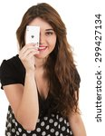 Small photo of Beautiful young girl holding ace of clubs card in her hand isolated on white