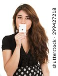 Small photo of Beautiful young girl holding ace of clubs card in front of her mouth isolated on white