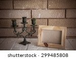 photo frame and candlestick on... | Shutterstock . vector #299485808