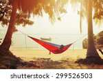 Resting In Hammock By The Sea ...