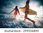 two ladies running into the sea ... | Shutterstock . vector #299556890