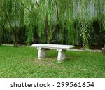 Stone Bench On Green Grass Wit...
