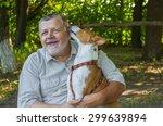 young basenji licks the master... | Shutterstock . vector #299639894