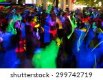 People Dancing In A Glow In Th...