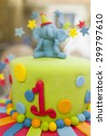 Small photo of First birthday cake. Colorful fondant decorating, close up.