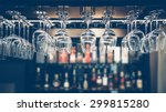 Stock photo empty glasses for wine above a bar rack in vintage tone 299815280