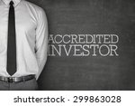 Small photo of Accredited investor text on blackboard with businessman on side