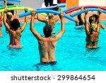 People Doing Water Aerobics In...