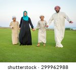 arabic family on green meadow... | Shutterstock . vector #299962988