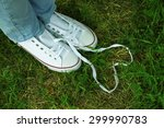 female feet in gum shoes on... | Shutterstock . vector #299990783