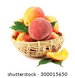 Ripe Peaches In Basket Isolate...
