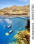 divers in blue hole  red sea ... | Shutterstock . vector #300023783